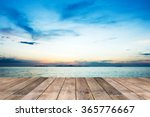 Perspective of wood terrace against beautiful seascape at sunset with free copy space use for background or backdrop.