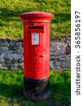 Small photo of WYMESWOLD, ENGLAND - JANUARY 15: A rural British red traditional Royal Mail pillar box. In Wymeswold, England on 15th January 2016.