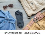 cloths  on wooden background | Shutterstock . vector #365886923