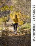 woman running at autumn park | Shutterstock . vector #365920793