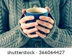 cup in woman's hands   Shutterstock . vector #366064427