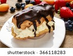 Small photo of Eclair cake and colorful fruits