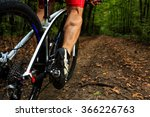 Cyclist Riding Mountain Bike O...