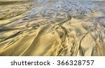 Small photo of Oil Sand Water