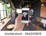 hand using smartphone in coffee ...   Shutterstock . vector #366345803
