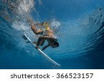 Surfer With Surf Board Dive...