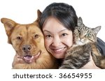 Stock photo woman hugging her dog and cat 36654955