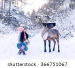 Girl And Reindeer. The Girl An...