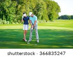 young couple playing golf | Shutterstock . vector #366835247