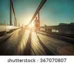 woman running on the bridge... | Shutterstock . vector #367070807