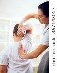 chiropractor doing adjustment... | Shutterstock . vector #367148057