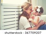 Small photo of Happy loving family. mother and child girl playing, kissing and hugging