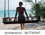 woman on a swing at the sea  | Shutterstock . vector #367734347