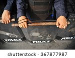 police in riot gear carrying...   Shutterstock . vector #367877987