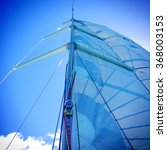 Small photo of The mainsail and rig of a sailing yacht.