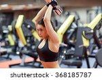 young woman flexing muscles...   Shutterstock . vector #368185787