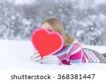 young happy woman hiding behind ... | Shutterstock . vector #368381447