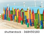Colorful Beach Huts In A Row O...