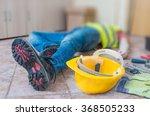 leg and yellow helmet of... | Shutterstock . vector #368505233