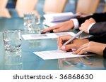 row of human hands holding pen... | Shutterstock . vector #36868630