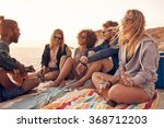 young friends enjoying a beach... | Shutterstock . vector #368712203