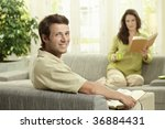 happy couple reading book... | Shutterstock . vector #36884431