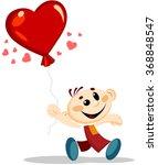 Boy Holds Heart Shaped Balloon.