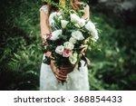 Stylish Boho Bride Holding ...