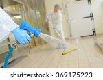 factory worker cleaning floor | Shutterstock . vector #369175223