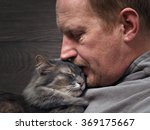 portrait of a man with a cat.... | Shutterstock . vector #369175667