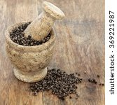 Small photo of Vitex agnus castus herb used in natural alternative herbal medicine in a mortar with pestle over old wood background. Used as an aphrodisiac and tonic for male female reproductive systems.