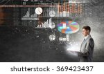 businessman with book | Shutterstock . vector #369423437