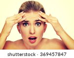 a young woman checking wrinkles ... | Shutterstock . vector #369457847