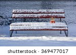 Snow Globe On Bench With Snow