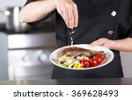 chef finishing her plate and...   Shutterstock . vector #369628493