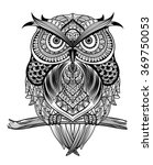 Stock vector vector hand drawn owl sitting on branch black and white zentangle art ethnic patterned 369750053