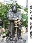 Small photo of Hong Kong, China - June 25, 2014: Chinese Zodiac Bronze Ox Stature at Sik Sik Yuen Wong Tai Sin Temple