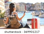 couple of tourists sitting... | Shutterstock . vector #369901217