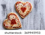Two Heart Shaped Pizzas With...
