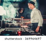 young male cook preparing meal... | Shutterstock . vector #369964697