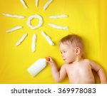 Little Boy With Suncream Bottl...
