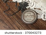 Small photo of Nineteen-sixty-nine South African five shilling on wood and white floral texture