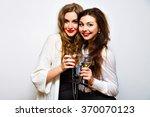 two joyful pretty friends... | Shutterstock . vector #370070123