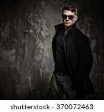 stylish young man in black coat ... | Shutterstock . vector #370072463