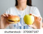 choose between junk food versus ... | Shutterstock . vector #370087187