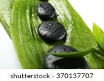 hot spa stones with bamboo ... | Shutterstock . vector #370137707