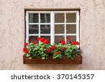 Window Decorated With Geranium...