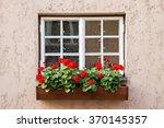 Window Decorated With Geranium...