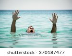 Drowning Man In Sea Asking For...
