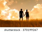 Couple In A Field Holding Hand...